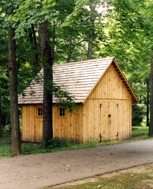 Garden shed with sawn siding and dear shake roof