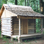 "Small log cabin built from sawn 6"" x 8"" logs with a white oak hand spilt roof"