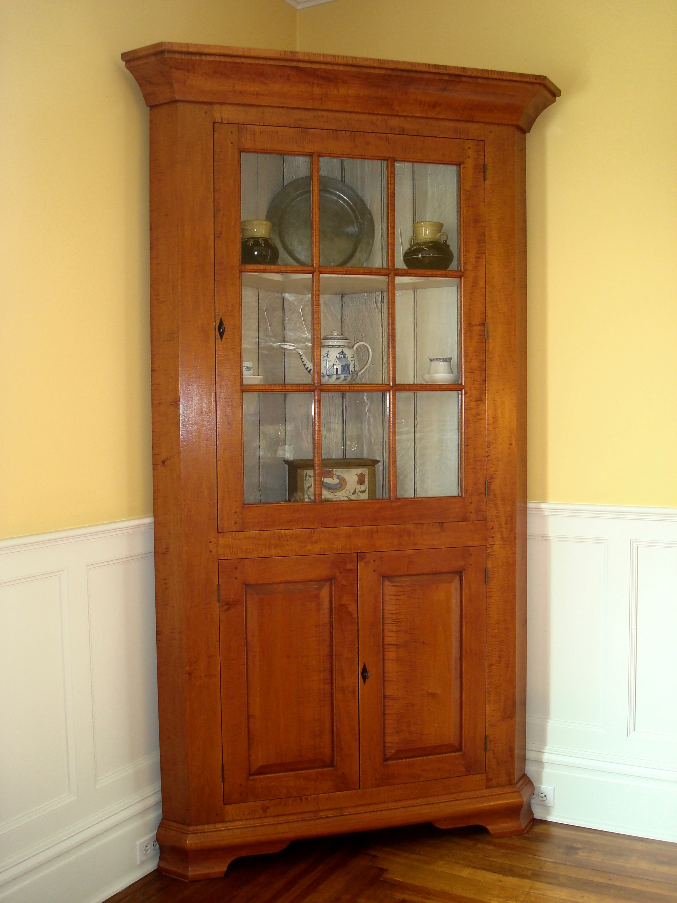 Standing curly maple cupboard with upper 9 lite glass door and 2 paneled lower doors