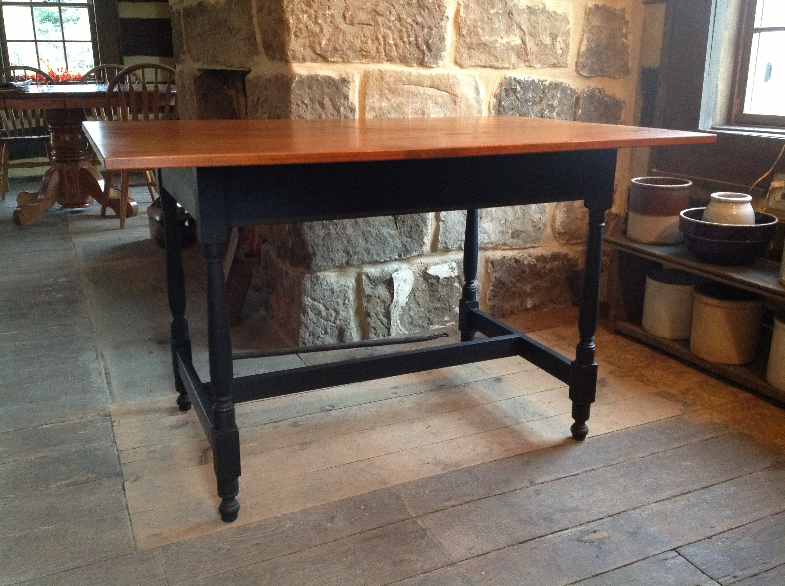 Tavern table with painted black under carriage and stained cherry top